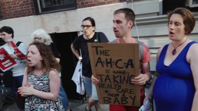 democratic socialists of america organized a rally titled 'emergency rally against trumpcare'. the protestors gathered outside the nyc gop followed... - emergency planning stock videos & royalty-free footage