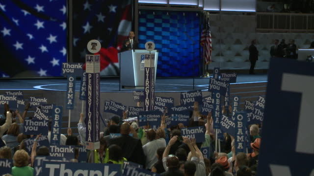 Democratic supporters hold Thank You Obama signs during President Obama's speech at the DNC 2016 Delegates from Pennsylvania and Virginia cheer him...