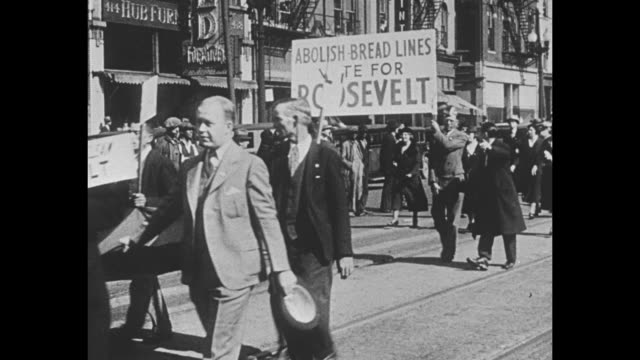 stockvideo's en b-roll-footage met democratic us presidential candidate franklin d roosevelt during 1932 campaign with shot of fdr in car / fdr supporters marching including sign... - d day