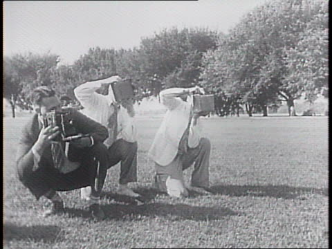 democratic vice president nominee henry wallace practices throwing a boomerang in front of of still photographers in a park - boomerang stock videos & royalty-free footage