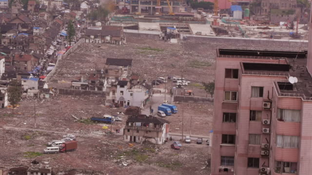 demolished block in shanghai - medium wide aerial shot - imperfection stock videos & royalty-free footage