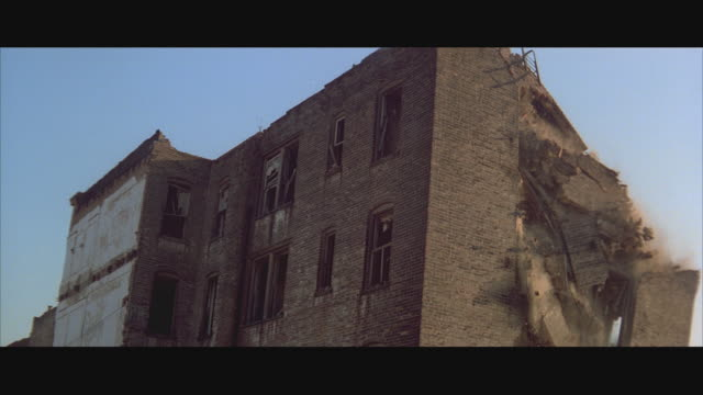ws slo mo demolishing of condemned brick building - demolishing stock videos & royalty-free footage