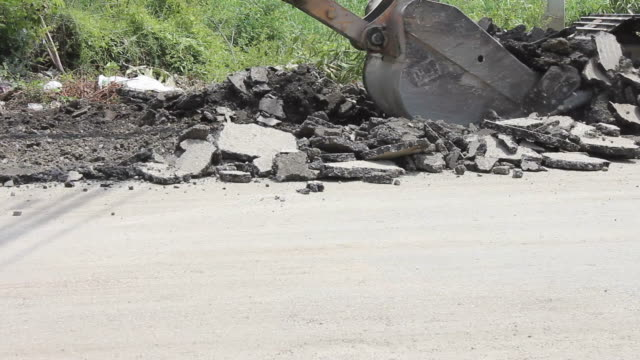 demolition asphalt. - vehicle scoop stock videos and b-roll footage