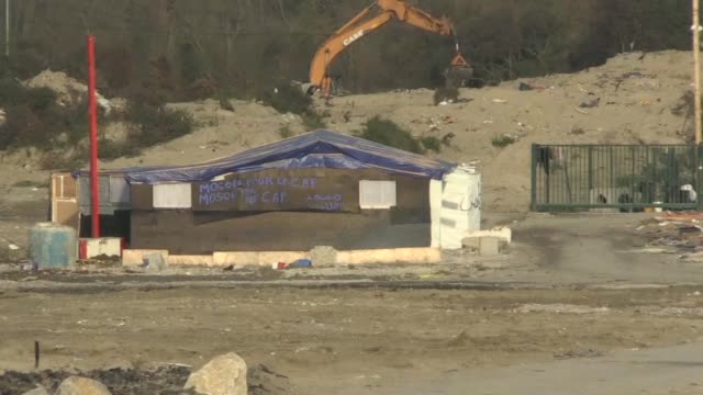 demolition crews destroyed the last shelters at the infamous jungle migrant camp in calais on monday afp reporters at the site said - infamous stock videos & royalty-free footage