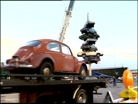 Demolition crews remove cars from 'Spindle' a sculpture featuring eight cars impaled on a 50foot spike installed in 1989 by artist Dustin Shuler in...