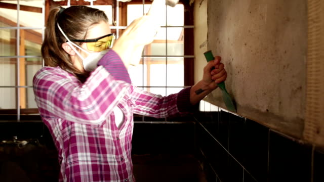 demolition day woman renovator - hammer stock videos and b-roll footage
