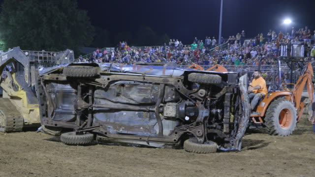 Demolition derby driver Allen Fuetz's car is turned back over after he flipped over James Lane's car when his accelerator got stuck before flipping...