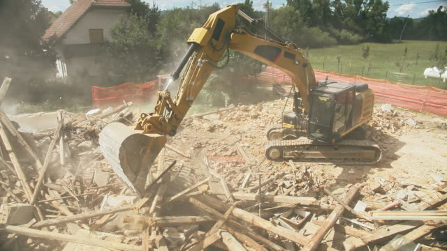 cs demolition excavator clearing the debris at the demolition site - excavator stock videos and b-roll footage