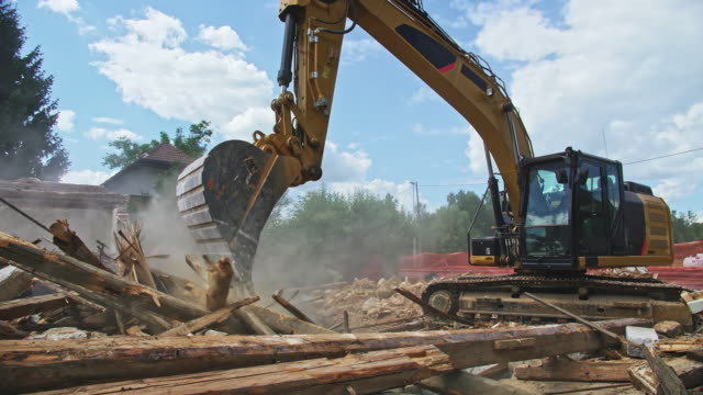 cs demolition excavator in operation at the site of an old building being taken down - construction equipment stock videos & royalty-free footage