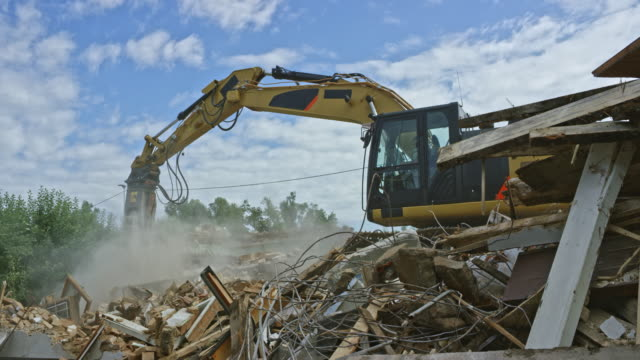 demolition excavator operating at the demolition site - construction equipment stock videos & royalty-free footage