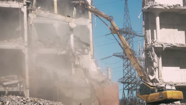 demolition of a building - demolishing stock videos & royalty-free footage