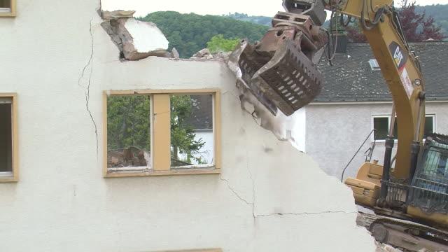ms demolition of apartment block / saarburg, rhineland-palatinate, germany - crane stock videos & royalty-free footage