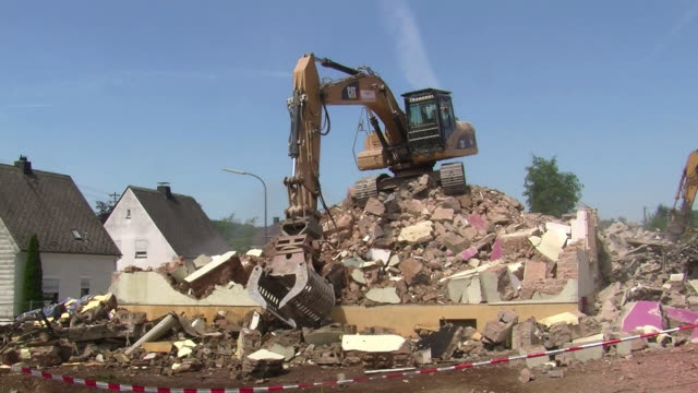 ms demolition of apartment block / saarburg, rhineland-palatinate, germany - bulldozer stock videos and b-roll footage