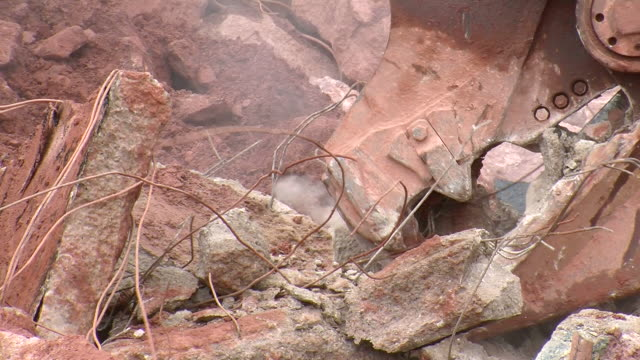 cu demolition of crushing machine at quarry by bulldozer / taben-rodt, rhineland-palatinate, germany - crane construction machinery stock videos & royalty-free footage