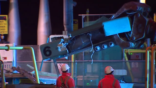 demolition workers dismantling the severn bridge toll booth barriers at night - dismantling stock videos & royalty-free footage