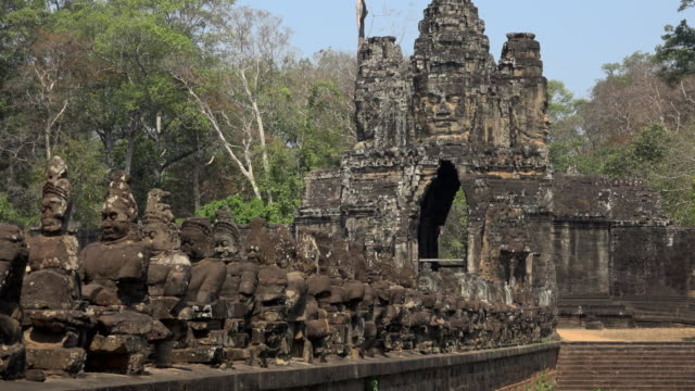 zo / 54 demon gods on causeway to south gate, entrance of angkor thom - moat stock videos and b-roll footage