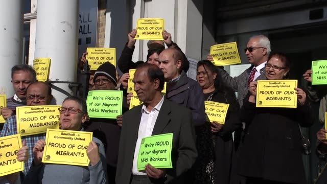 Demonatrations in support of migrants ENGLAND London Southall EXT Various of people demonstrating in support of migrants on steps of building /...