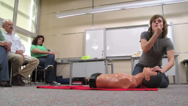 hd: demonstrating artificial respiration on a dummy - first aid stock videos & royalty-free footage