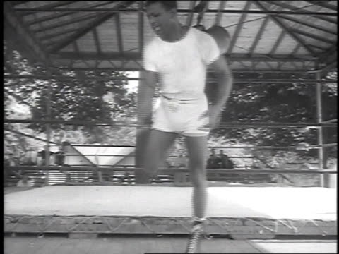 demonstrating footwork in slow motion / wife rubbing him down - 1951 stock-videos und b-roll-filmmaterial
