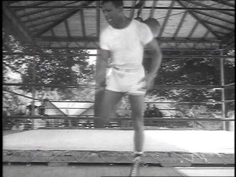 stockvideo's en b-roll-footage met demonstrating footwork in slow motion / wife rubbing him down - 1951
