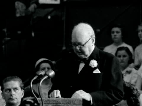 demonstration addressed by winston churchill england london ext albert hall / man selling buttonholes / sir winston churchill and lady churchill... - winston churchill prime minister stock videos and b-roll footage