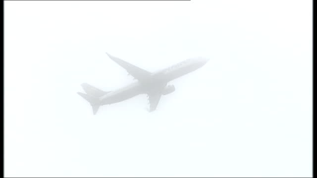 demonstration against stansted airport expansion held date unknown ryanair plane away through clouds - ライアンエアー点の映像素材/bロール