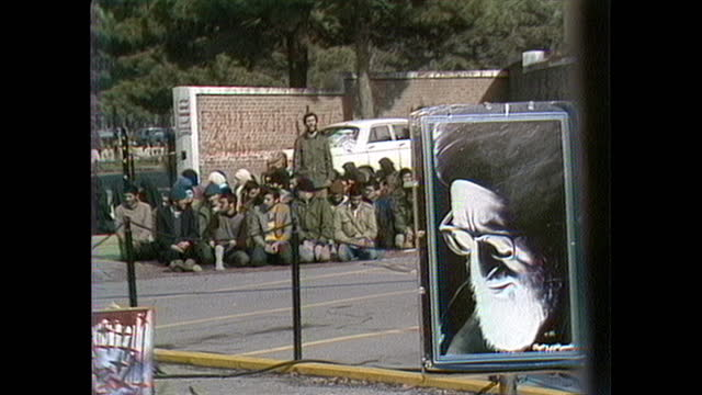 demonstration and morning prayers outside the us embassy in tehran. - hostage stock videos & royalty-free footage