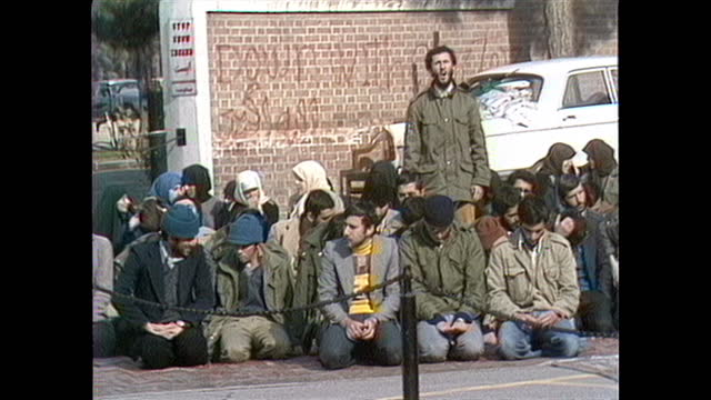 demonstration and morning prayers outside the us embassy in tehran. - 1979 stock videos & royalty-free footage