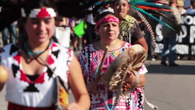 demonstration for national day of protest to stop police brutality repression and the criminalization of a generation in downtown la aztec dancers... - latin american civilizations stock videos and b-roll footage