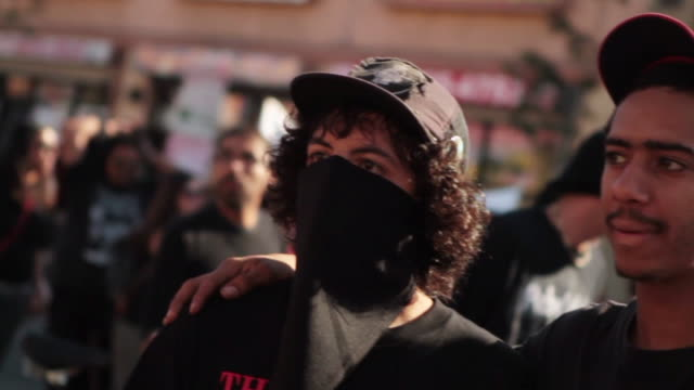 demonstration for national day of protest to stop police brutality, repression, and the criminalization of a generation in downtown l.a. - personal hygiene product stock videos & royalty-free footage