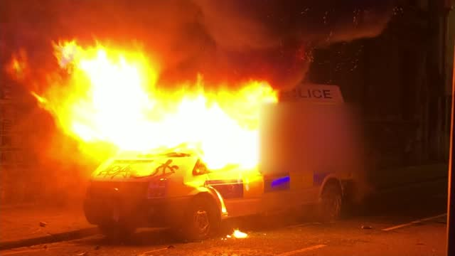 demonstration in bristol leads to clashes between police and protesters; england: bristol: shaky camera police van burning as people film on mobile... - shaky stock videos & royalty-free footage