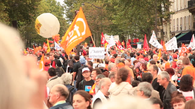 demonstration in paris. general strike in france 24 september 2010. civil servants and private sector employees protesting government plans to raise the pension age from 60 to 62 years. - protestor stock videos & royalty-free footage