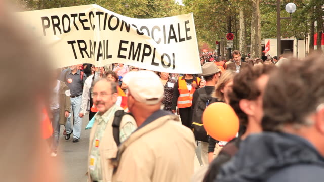 demonstration in paris. general strike in france 24 september 2010. civil servants and private sector employees protesting government plans to raise the pension age from 60 to 62 years. - marching stock videos and b-roll footage