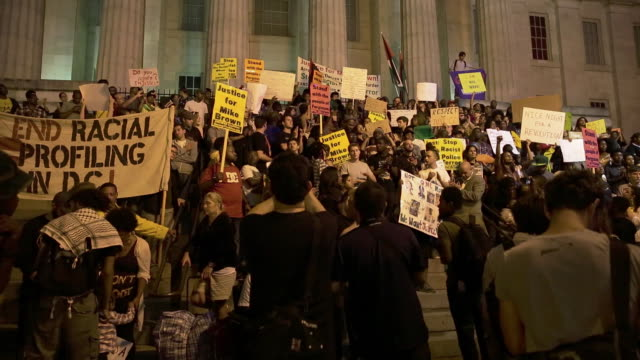demonstration in support of michael brown in the chinatown area of washington dc - western script stock videos & royalty-free footage