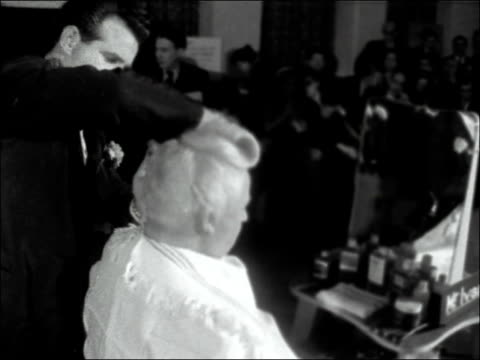 Demonstration of men's hairdressing ENGLAND London Bonnington Hotel INT People taking part in a demonstration of hairdressing skills by the...