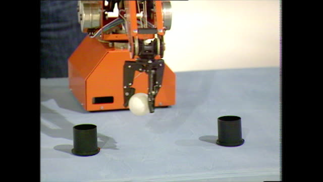 demonstration of robot arm picking up and moving ball; 1983 - construction machinery stock videos & royalty-free footage