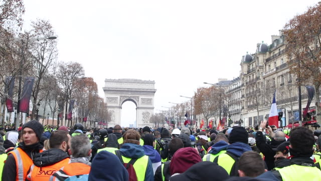 demonstration of yellow vests in front of the triumphal arch back view - reflective clothing stock videos & royalty-free footage