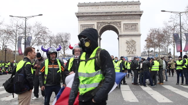 demonstration of yellow vests in front of the triumphal arch gas mask - reflective clothing stock videos & royalty-free footage