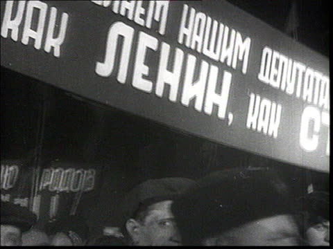 demonstration on moscow red square at night, demonstrators hold portraits of stalin and molotov, stalin wearing fur coat and hat saluting people from... - 1930 stock videos & royalty-free footage