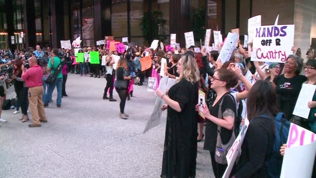 demonstration was held in front of trump tower on oct. 18 in response to some lewd comments about women that donald trump was caught making on a hot... - shock tactics stock videos & royalty-free footage