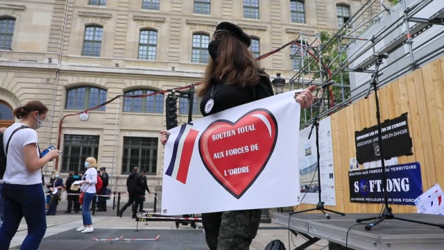 a demonstrator holds a sign that says total support for our police forces during the collective ffoc rally in support of the police force on june 27... - femininity stock videos & royalty-free footage