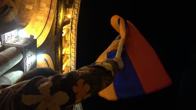 demonstrator holds up the armenian flag as he takes part in a protest against the end of war in nagorno karabakh in front of the building housing the... - eastern european culture video stock e b–roll