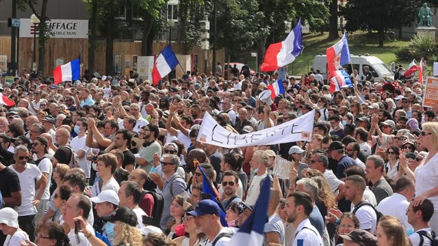 demonstrator waves a french flag on the place du trocadéro and the eiffel tower during a demonstration against the health passport under the slogan... - france stock videos & royalty-free footage