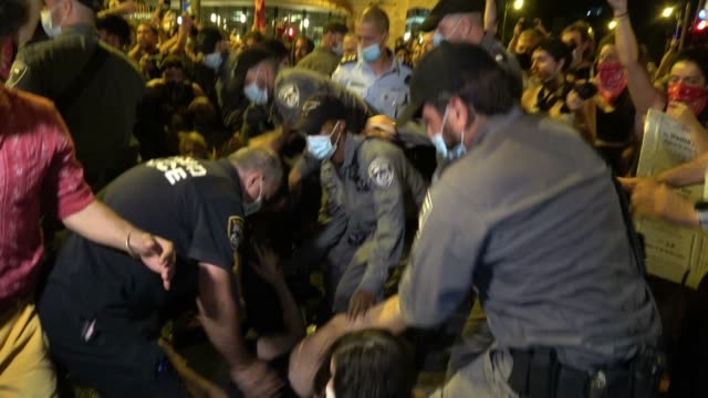 demonstrators are dragged away by policemen following scuffles between protesters and the police as demonstrators gather in front of the official... - fighting stock videos & royalty-free footage