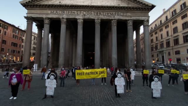 demonstrators attend a flash mob organized by amnesty international to ask the release of student patrick george zaky, on october 8, 2020 in rome,... - 映像技法点の映像素材/bロール