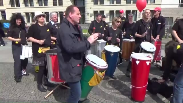 demonstrators attend a rally of the german confederation of trade unions on may 1 2015 in berlin germany may day or international workers' day was... - may day international workers day stock videos & royalty-free footage