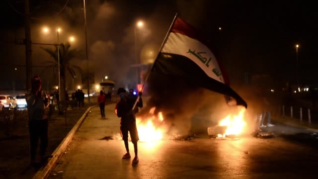 demonstrators block a road in the iraqi holy city of najaf after the appointment of a new prime minister mohammed allawi 65 chosen to form a... - najaf stock videos & royalty-free footage