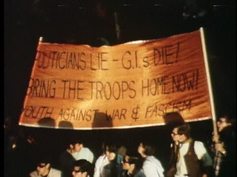 demonstrators carry an anti-war banner at the chicago democratic national convention. - vietnamkriget bildbanksvideor och videomaterial från bakom kulisserna