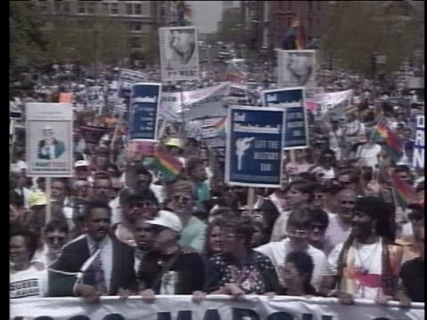 demonstrators carry signs and banners in the nation's capital during the 1993 march on washington for lesbian, gay and bi equal rights and liberation. - human rights or social issues or immigration or employment and labor or protest or riot or lgbtqi rights or women's rights stock videos & royalty-free footage