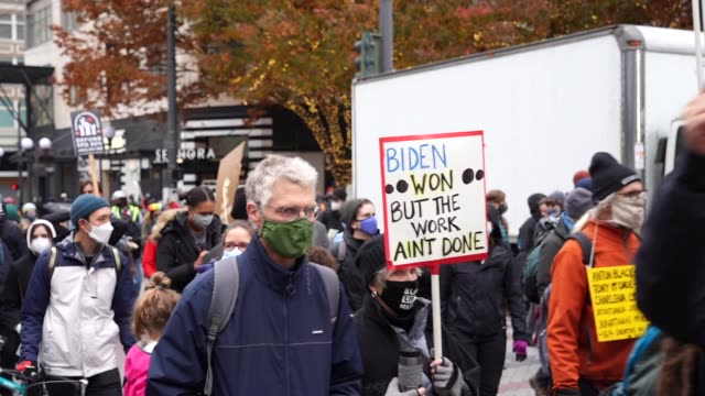 """demonstrators celebrate and march to """"count every vote, protect every person"""" in downtown seattle, washington on november 7, 2020 after major news... - washington state stock videos & royalty-free footage"""